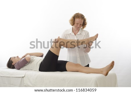 Kinesiologist or physiotherapist treating Piriformis - stock photo