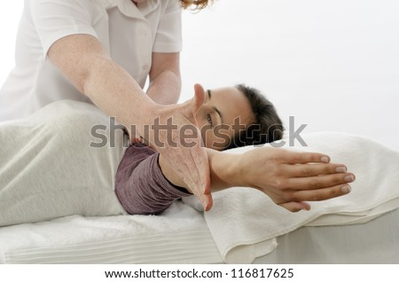 Kinesiologist or physiotherapist treating Trapezius - stock photo