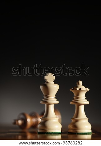 king and queen chess pieces. Low depth of field, focus on foreground. - stock photo