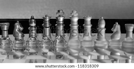 King & Chess Pieces - business concept series - strategy, team, company, conference, business merger, competition, business leadership, survival - black and white panoramic - chess set or chess match. - stock photo
