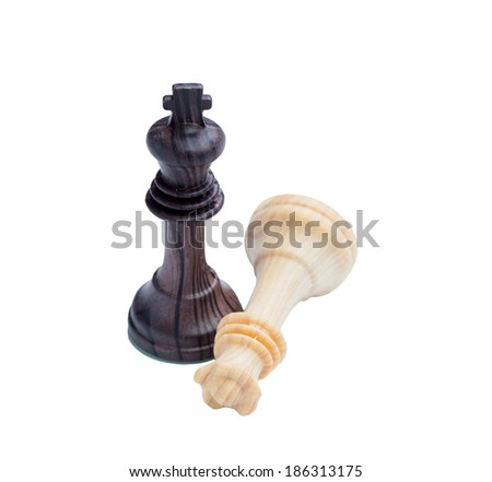 King defeating Queen. Wooden chess pieces on chessboard - stock photo