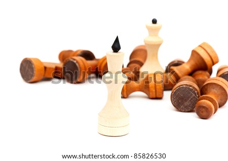 King in the foreground against a background of black army chips. - stock photo