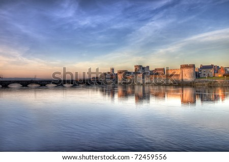 King John castle at sunset on the river Shannon in Limerick, Ireland. - stock photo
