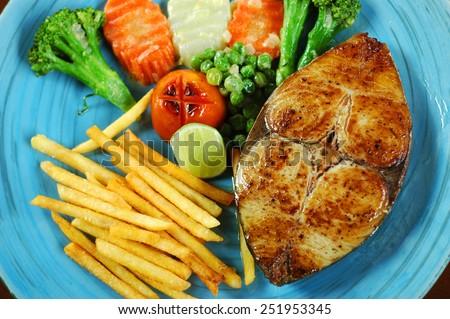 King mackerel steak with french fries - stock photo