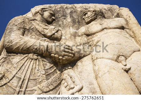 King Mithridates shaking hands with god Herakles, Adiyaman, Turkey - stock photo