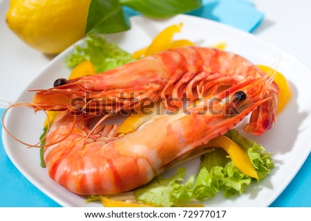 king prawns with salad on a plate - stock photo