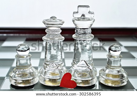 King, queen and pawns on chess board (Happy family concept)  - stock photo