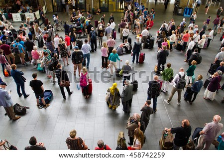 KING'S CROSS STATION, LONDON, UK - JULY 21, 2016. Crowds of commuters and passengers waiting for information at King's Cross station in London, UK. - stock photo
