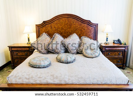 King size bed with pillows in luxury bedroom