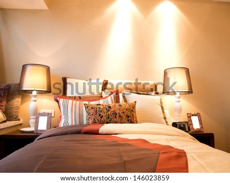 King sized bed in a business hotel room. - stock photo