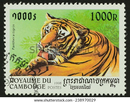 Kingdom of Cambodia - CIRCA 1998 : A stamp printed in CAMBODGE shows image of tiger (Panthera tigris) ,1998 - stock photo