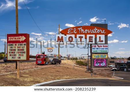 KINGMAN, AZ - MAY 8, 2014:  Route 66 landmark El Trovatore motel in Kingman Arizona.  This historic roadside motel is one of the few pre-World War II Kingman Arizona motels that are still standing. - stock photo