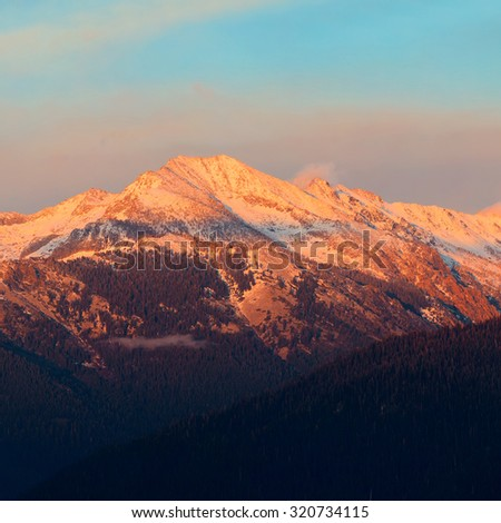 Kings Canyon mountain with snow and cloud at sunset - stock photo