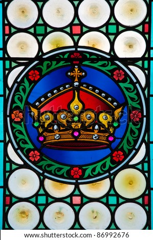 Kings Crown, a colorful vitrage stained glass from St. Vitus cathedral in Prague. - stock photo
