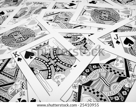 Kings queens and jacks playing cards in black and white - stock photo