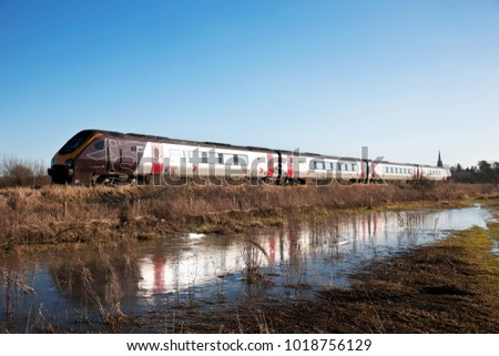 KINGS SUTTON, UK - JANUARY 19: A Cross Country operated class 220 diesel express passenger service heads towards Newcastle carrying commuters on January 19, 2015 in Kings Sutton.