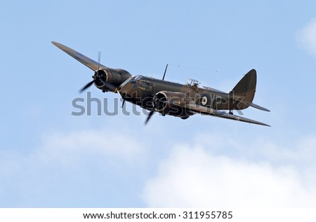KINGSHILL, UK - JULY 5: A vintage WW2 Bristol Blenheim bomber aircraft gives a low past before flying back to base, at the Old Warden aerodrome on July 5, 2015 in Kingshill