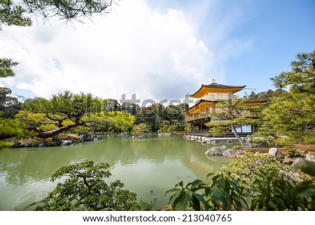 Kinkakuji (Golden Pavilion) is a Zen temple in northern Kyoto whose top two floors are completely covered in gold leaf. - stock photo