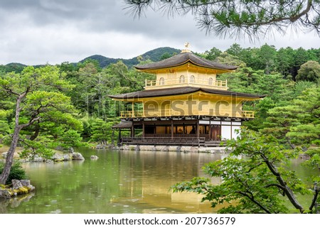 Kinkakuji Temple (Golden Pavilion) in rainy summer in Kyoto, Japan. - stock photo