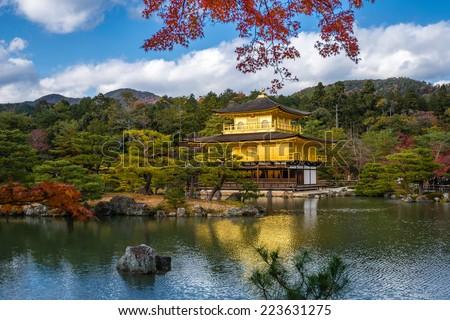 Kinkakuji Temple (The Golden Pavilion) with autumn maple in Kyoto - stock photo