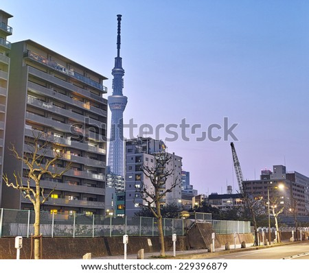 KINSHICHO, TOKYO - APRIL 16, 2014: Tokyo Skytree iluminated at night seen between buildings, photographed from the south of Kinshicho district, downtown Tokyo, Japan (Long time exposure). - stock photo