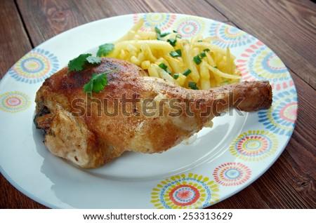 Kip met frieten - traditional dish in Belgium fried chicken with fries - stock photo