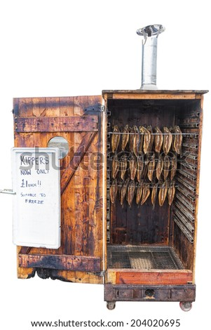 Kipper Smokehouse with burnt bottom edge to the door, Sitting on wheels, and  filled with kippers offered at a £1 each Isolated  on white (Copy space) - stock photo