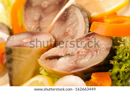 Kipper with vegetables close-up - stock photo