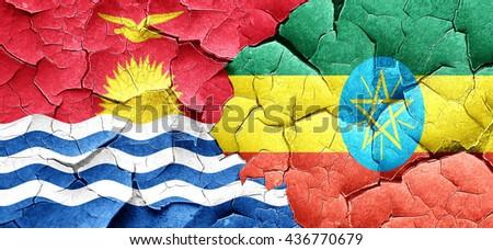 Kiribati flag with Ethiopia flag on a grunge cracked wall - stock photo