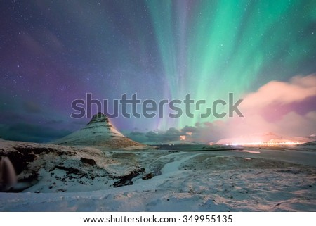 Kirkjufell Mountain with the Northern Light Iceland - stock photo