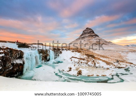 Kirkjufell or The Church mountain in Icelandic in winter with Kirkjufellfoss as foreground on Snaefellsnes peninsula, near the town of Grundarfjordur, north coast of Iceland.