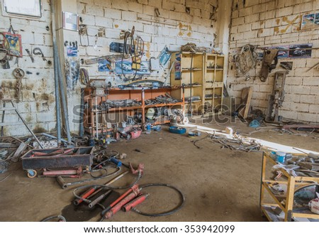 Kirkuk, Iraq - December 21, 2015: Interior of car repair garage in Iraq used for blacksmithing outer body  of damaged vehicles - stock photo