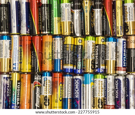 KIROV, RUSSIA - NOVEMBER 02, 2014: Different types of used batteries ready for recycling lying in the table on November 02, 2013 in Kirov, Russia. Type is AA - stock photo