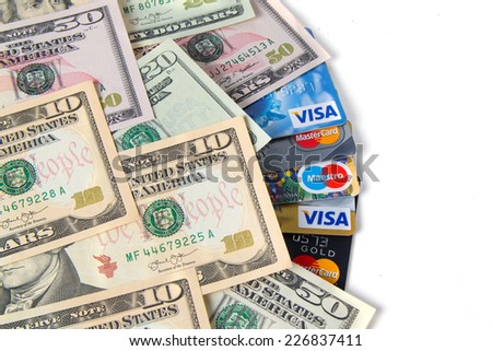 KIROV, RUSSIA - OCTOBER 25, 2014: Photo of VISA and Mastercard credit card with USA dollars bills - stock photo