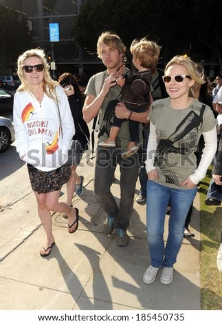 Kirsten Dunst, Ryan Hansen, Kristen Bell at Invisible Children's Global Event The Rescue, Santa Monica Pier to City Hall, Los Angeles, CA April 25, 2009 - stock photo
