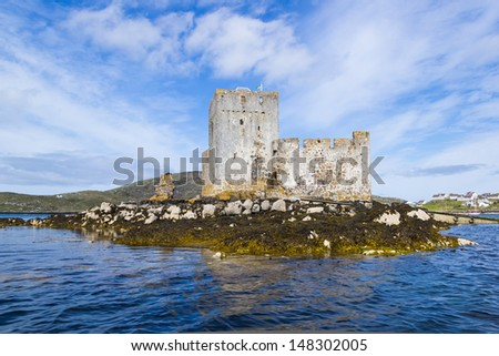 Kisimul Castle is a small medieval castle located in the center of Castlebay on Barra, an island of the Outer Hebrides, Scotland.  - stock photo