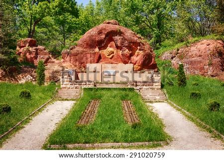 KISLOVODSK, RUSSIA - MAY 21 2015: Vladimir Lenin bas-relief memorial at Red Rocks (Krasnie Kamni) in Kurortny park - stock photo