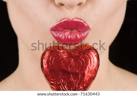 Kiss and chocolate heart shaped candy