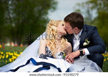 Kiss groom and happy bride in wedding walk - stock photo
