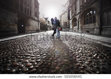 kiss in the middle of the street - stock photo