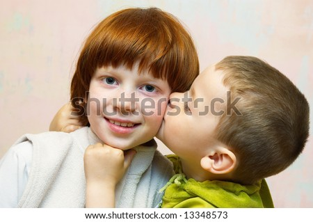 Kiss of the brother and sister - stock photo