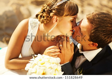 kiss on wedding day - stock photo