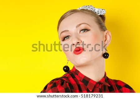 kiss portrait of a woman on a yellow background, red lips