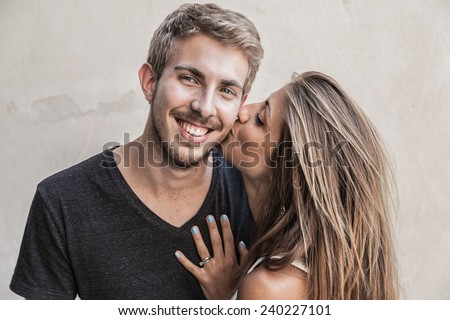 Kiss Young Couple - stock photo