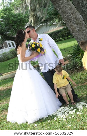 kissing bride and groom - stock photo
