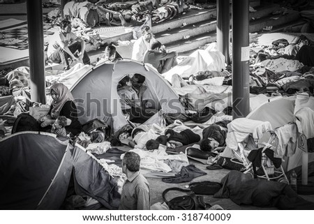 Kissing couple at Transit Zone Budapest, Keleti Railway Station - Hungary. August 30, 2015. Refugees at the Keleti Railway Station are arriving to Hungary on the way to Germany. - stock photo