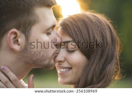 Kissing couple close up - stock photo