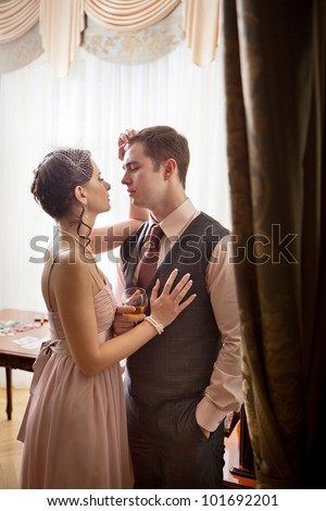 Kissing couple on the vintage interior background. - stock photo