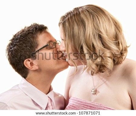 Kissing female couple close up over white