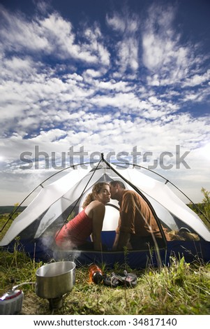 Kissing in a tent - stock photo